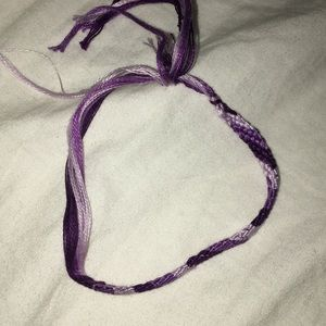 threaded lavender,purple, and dark purple bracelet